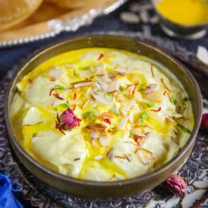 Shrikhand is a popular Indian dessert made using yogurt flavored with ground cardamom and sugar. Make it by thickening plain yogurt or take a shortcut and make it using Greek yogurt, the choice is yours!