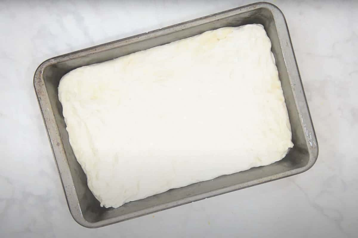 Dough stretched in baking tray