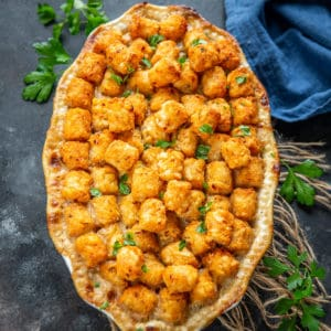 A delicious Casserole recipe, Tater Tot Casserole or Cow Boy Casserole is filled with the goodness of ground chicken, beans, corn, soup, cheese, and tater tots. Here is how to make it.