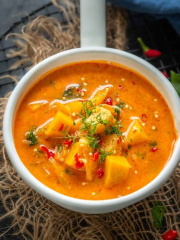 Make this spicy Thai Pumpkin Curry in under 20 minutes for your weeknight dinner. It's gluten-free, super delicious, and can be easily made vegan too. Here is how to make it.