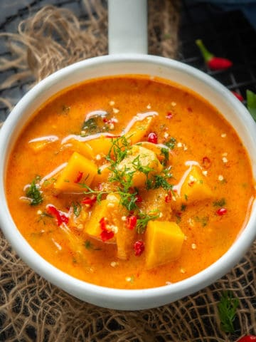 Make this spicy Thai Pumpkin Curry in under 20 minutes for your weeknight dinner. It's gluten-free, super delicious, and can be easily made vegan too.