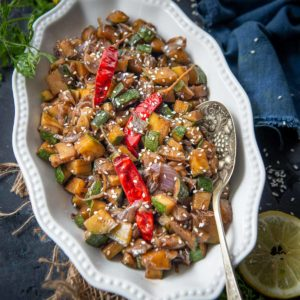 Make this Asian inspired quick and healthy Zucchini Stir Fry in under 15 minutes. It is a great side dish that goes well with any meal.