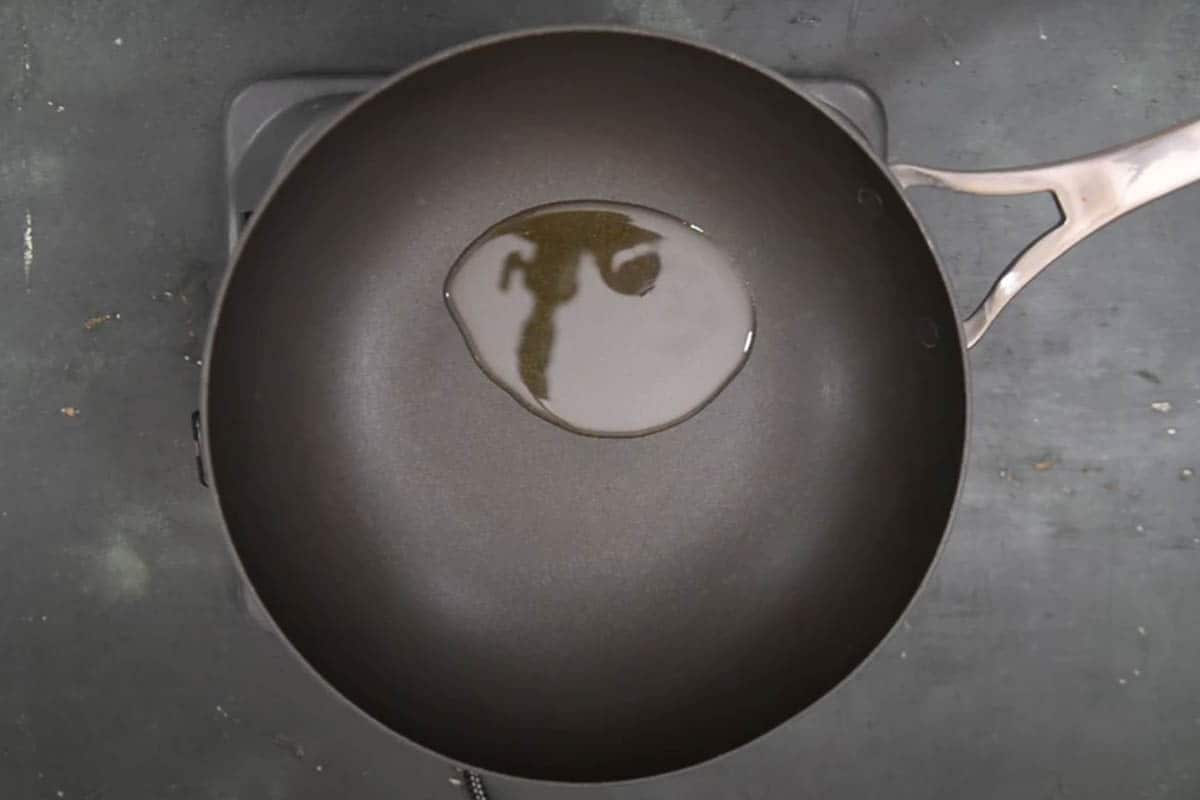 Oil added to a pan.