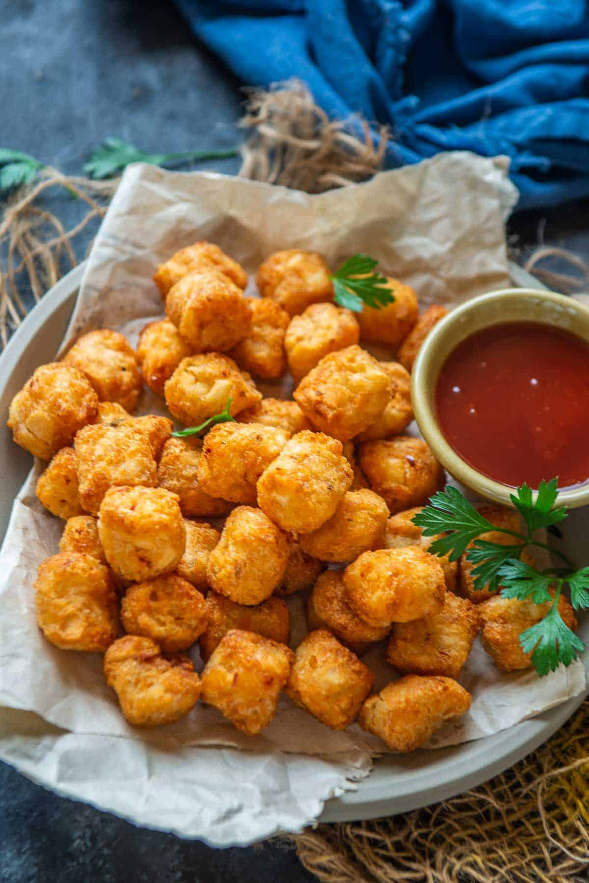 Air fryer tater tots served in a bowl.
