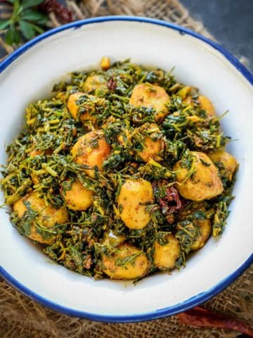 Made with the combination of potatoes, fresh fenugreek leaves, and everyday spices, Aloo Methi is a simple yet delicious stir fry that can be prepared for your everyday lunch box or a side dish with your Indian meals. Here is how to make it.