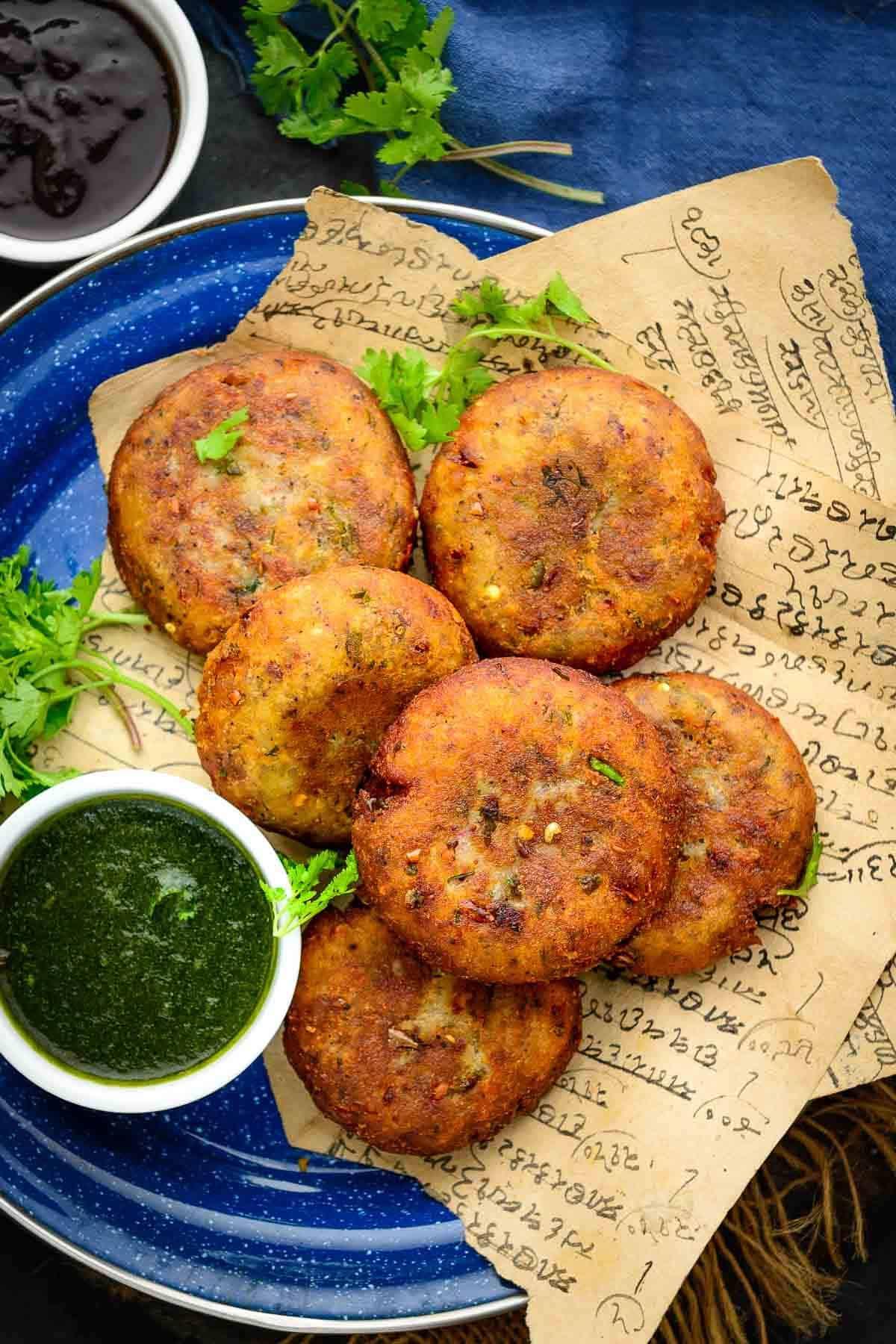 Aloo tikki served on a plate.