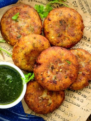 Crispy & crunchy, aloo tikki is a popular North Indian street food made using potatoes. Potatoes are mixed with herbs and spices, made into patties, and fried until crispy. It is one of the most popular chaat items and can be made easily at home.