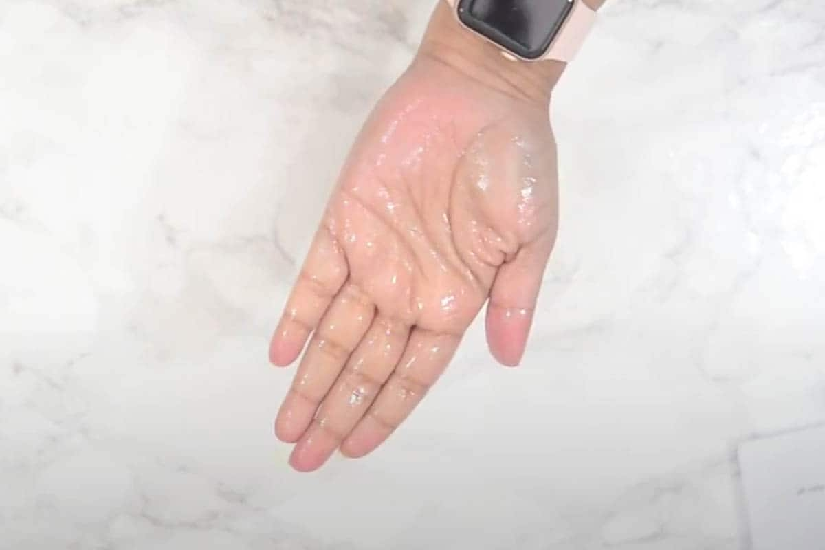 Hands greased with oil.