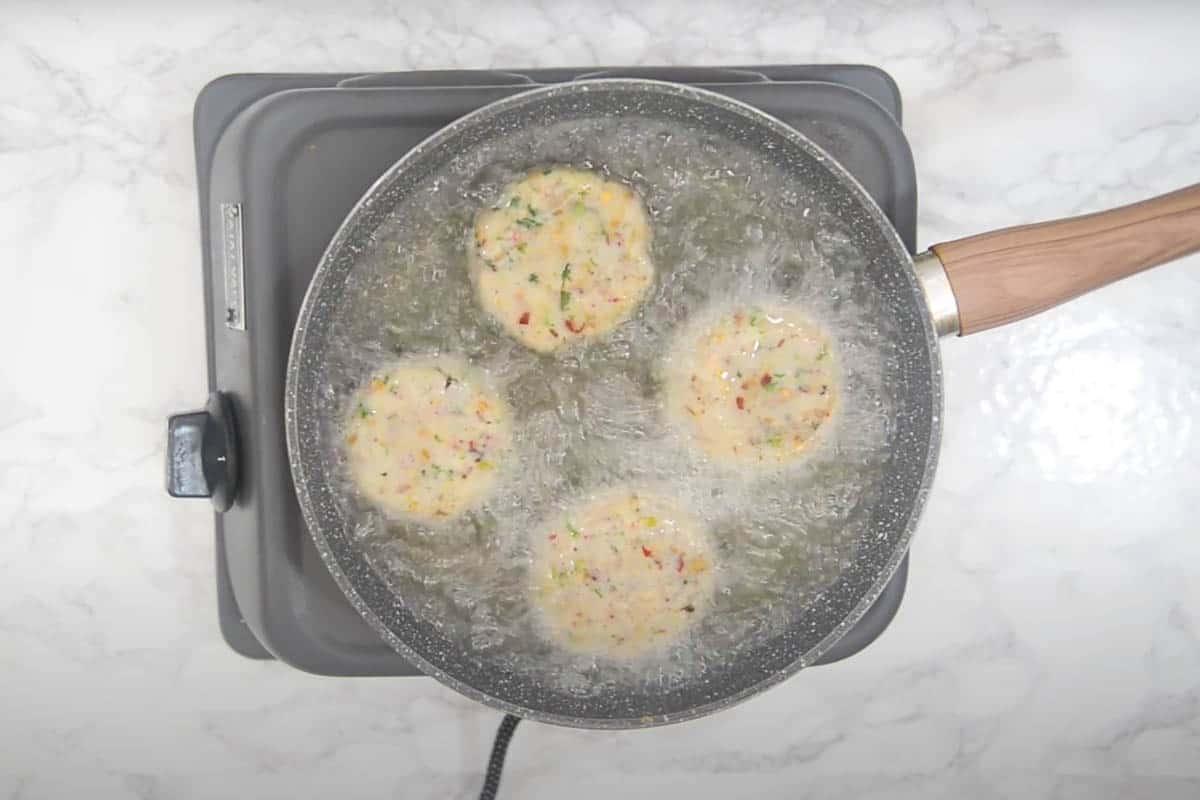 Tikki frying in hot oil.
