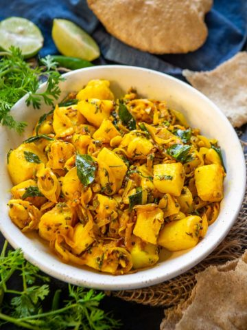 Spiced with basic spices, Batata Bhaji is a simple Maharashtrian potato sabzi that pairs very well with puri, chapati, or even pav. You can even re-purpose it to make sandwiches, stuffed idli, dosa stuffing, or paratha stuffing.