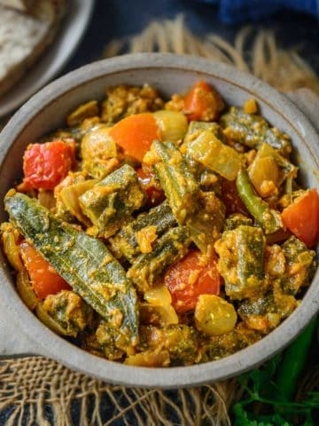 Cooked with lots of onions, Bhindi Do Pyaza is an Indian vegetarian curry made with Okra which is everyone's favorite. It is a great gluten-free dish to serve with Indian bread. Here is how to make it.