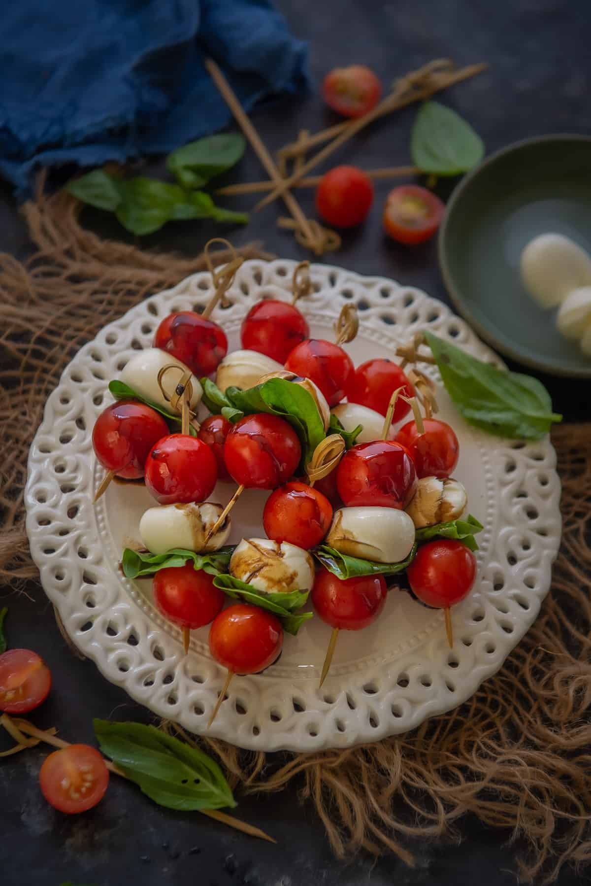 Caprese skewers served on a plate.