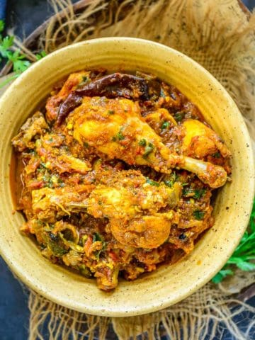 Bold, spicy, and full of flavors, Chicken Masala is a delicious Indian Chicken Curry, where marinated chicken is cooked in tomato-onion gravy. Serve it with Chapati and Kachumber Salad for a hearty meal. Here is how to make it.