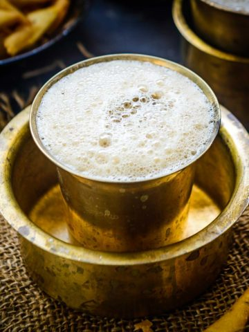 South Indian Filter Coffee is a traditional Indian style coffee that is made using a special filter. A coffee decoction is brewed which is then mixed with hot milk and sugar to create a perfect cuppa. Learn to make filter coffee in true South Indian style and serve it in a tumbler in style.