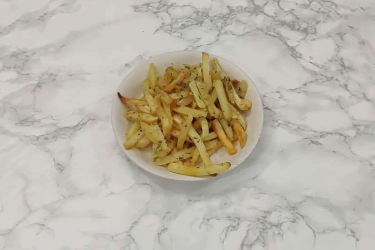 Fries transferred on a serving plate.