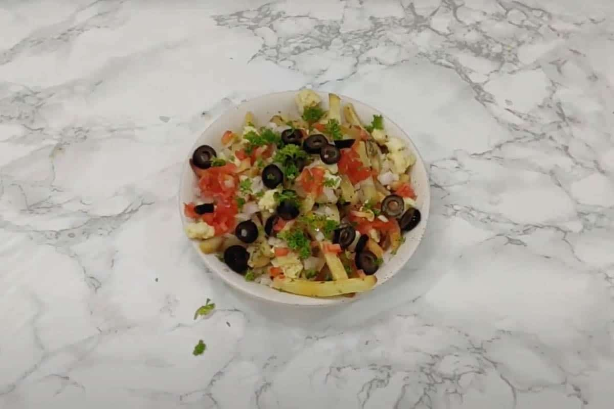 Greek fries topped with feta cheese, onion, tomato, olives and parsley.