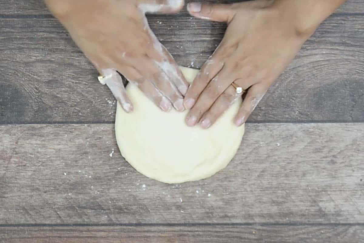 Dough ball pressed to make a 4 inch square.