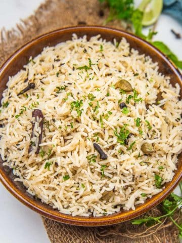 This Jeera Rice tastes exactly like the one served at your favorite restaurant - fluffy, perfectly cooked, non-sticky, aromatic, and flavourful. Make it with minimal ingredients in under 20 minutes.