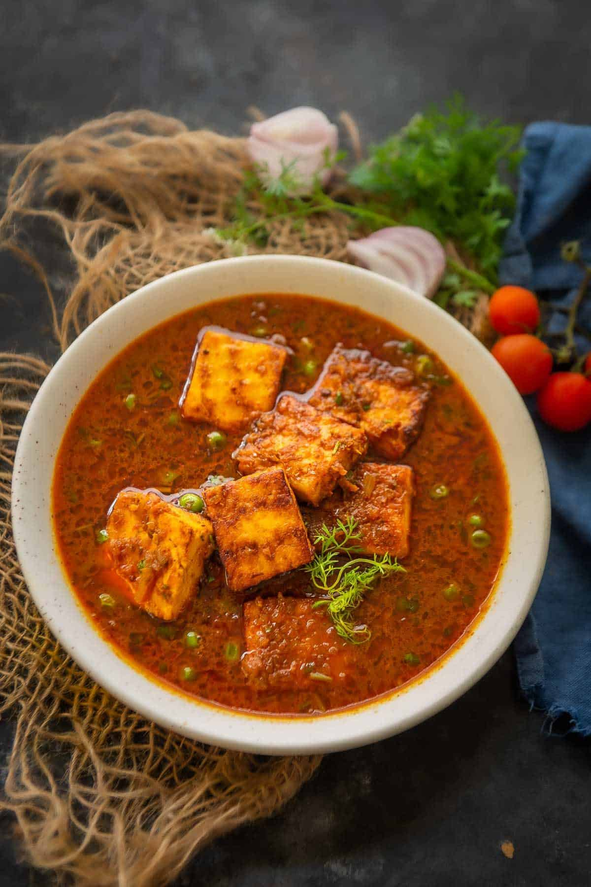 Matar paneer served in a bowl.