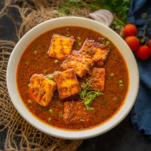 Made using fresh paneer and green peas, matar paneer is one of the most popular Indian curries. This creamy and spicy curry is made by simmering peas and paneer in an onion-tomato-based gravy. Make it for special occasions or everyday meals, it's going to be a hit always (gluten-free, can be made vegan)