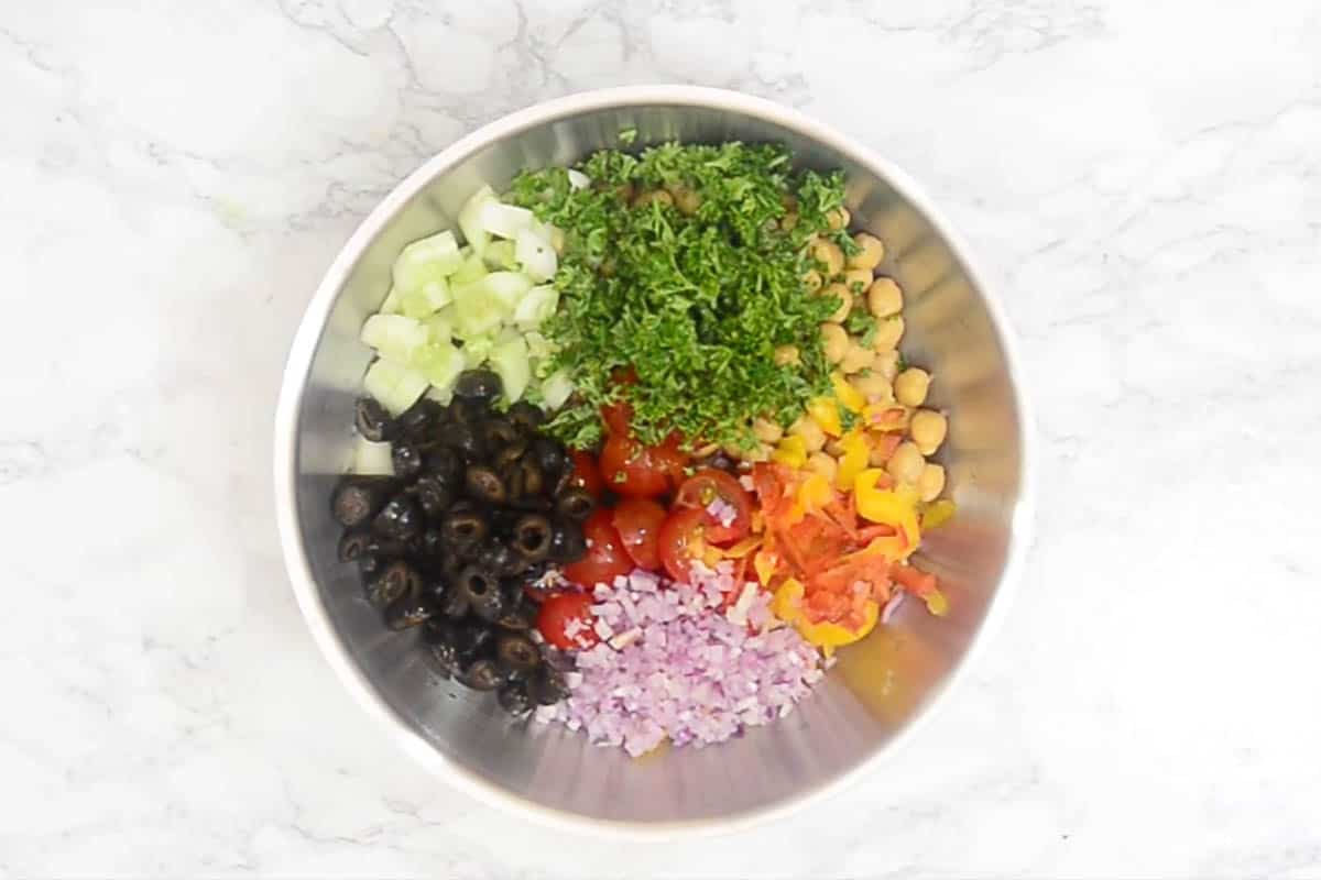 Salad ingredients mixed in a bowl.