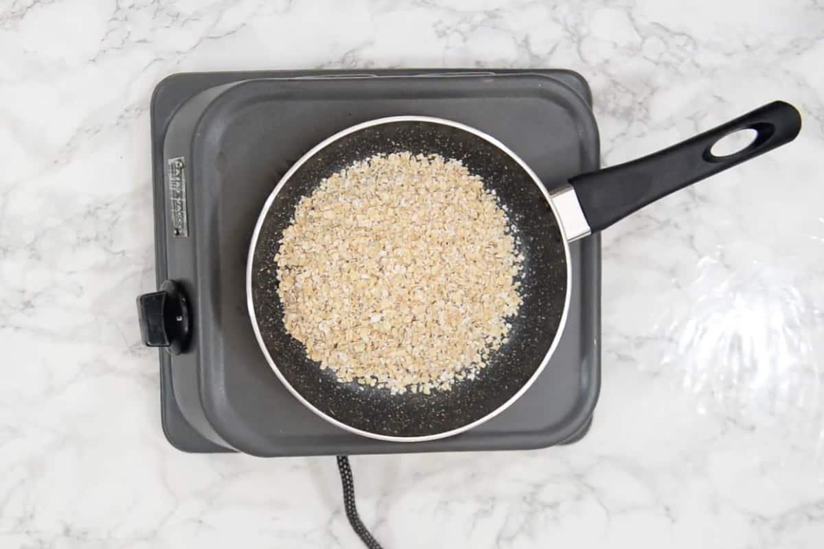 Oats roasting in a pan.
