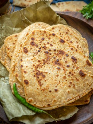 Plain paratha or tawa paratha is an Indian flatbread made using whole wheat flour. It's prepared in a lot of households almost on a daily basis. Here is how to make it.