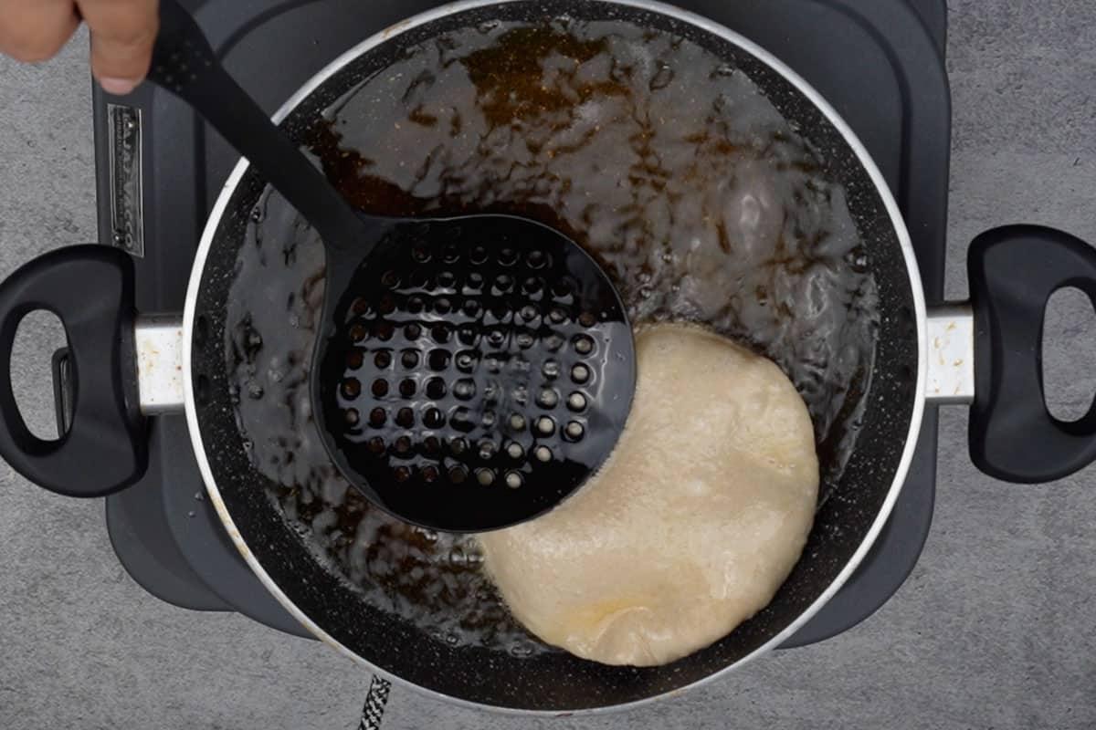 Poori frying in hot oil.