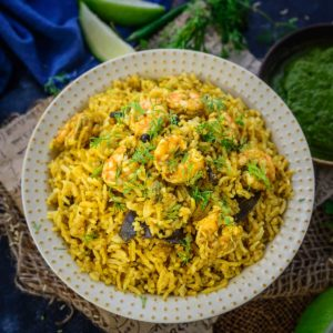 Made by cooking rice along with prawns, onions, tomatoes, ginger, garlic, and everyday spices, this Prawn Pulao or Shrimp Pulao is a simple and flavourful recipe. Try it for your weekday meals and you will love every bite of it.