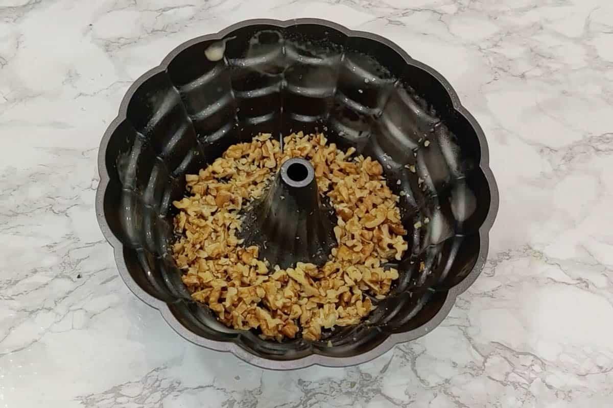 walnuts added in the prepared bundt cake pan.