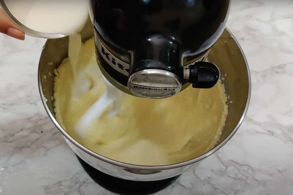 Milk, and vanilla extract added to the bowl.