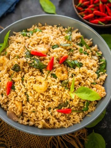 This spicy Thai fried rice (Khao Pad) is super easy to make and comes together in under 30 minutes. Try this authentic recipe and serve it as a side dish or main course.