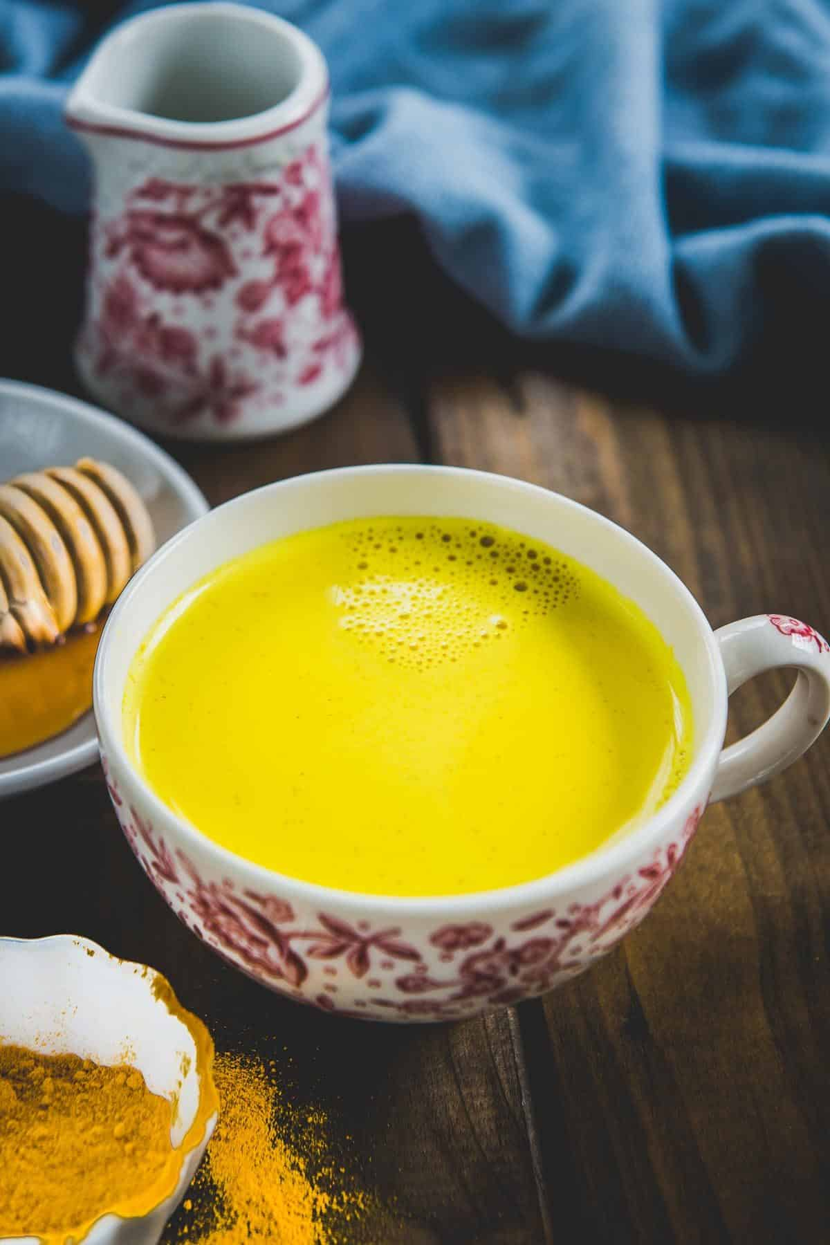 Turmeric milk served in a cup.