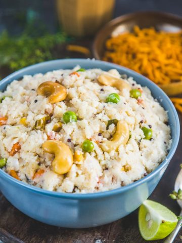 Upma (Rava Upma) is a popular Indian breakfast dish made using fine semolina, onion, mild spices, and a few more ingredients. It is filling and nutritious and comes together in under 20 minutes. My recipe makes the best fluffy and non-sticky Rava Upma in a jiffy.