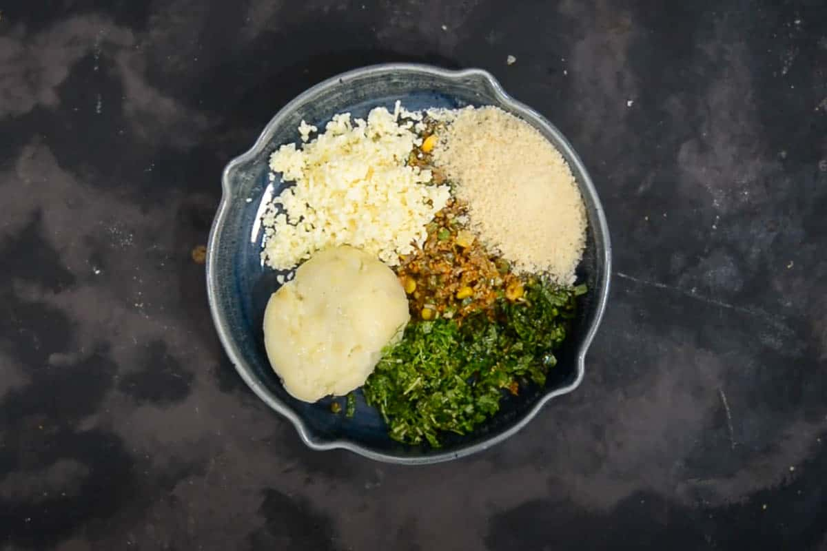 Paneer, boiled potato, cilantro, mint, lime juice bread crumbs added to the cooled mixture.