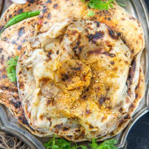 Crispy Flaky Amritsari Aloo Kulcha is an Indian bread which is everyone's' favorite. Make this restaurant-style fermented bread at home using my simple recipe.