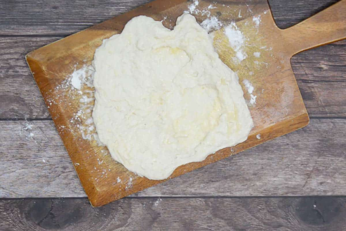 Dough spread again and slathered with butter.