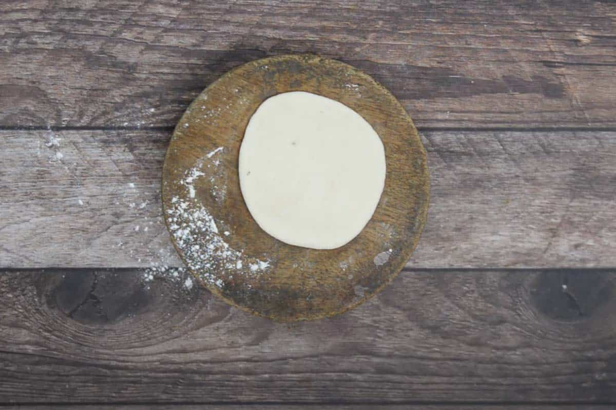 Dough ball rolled to make a 4 inch circle.