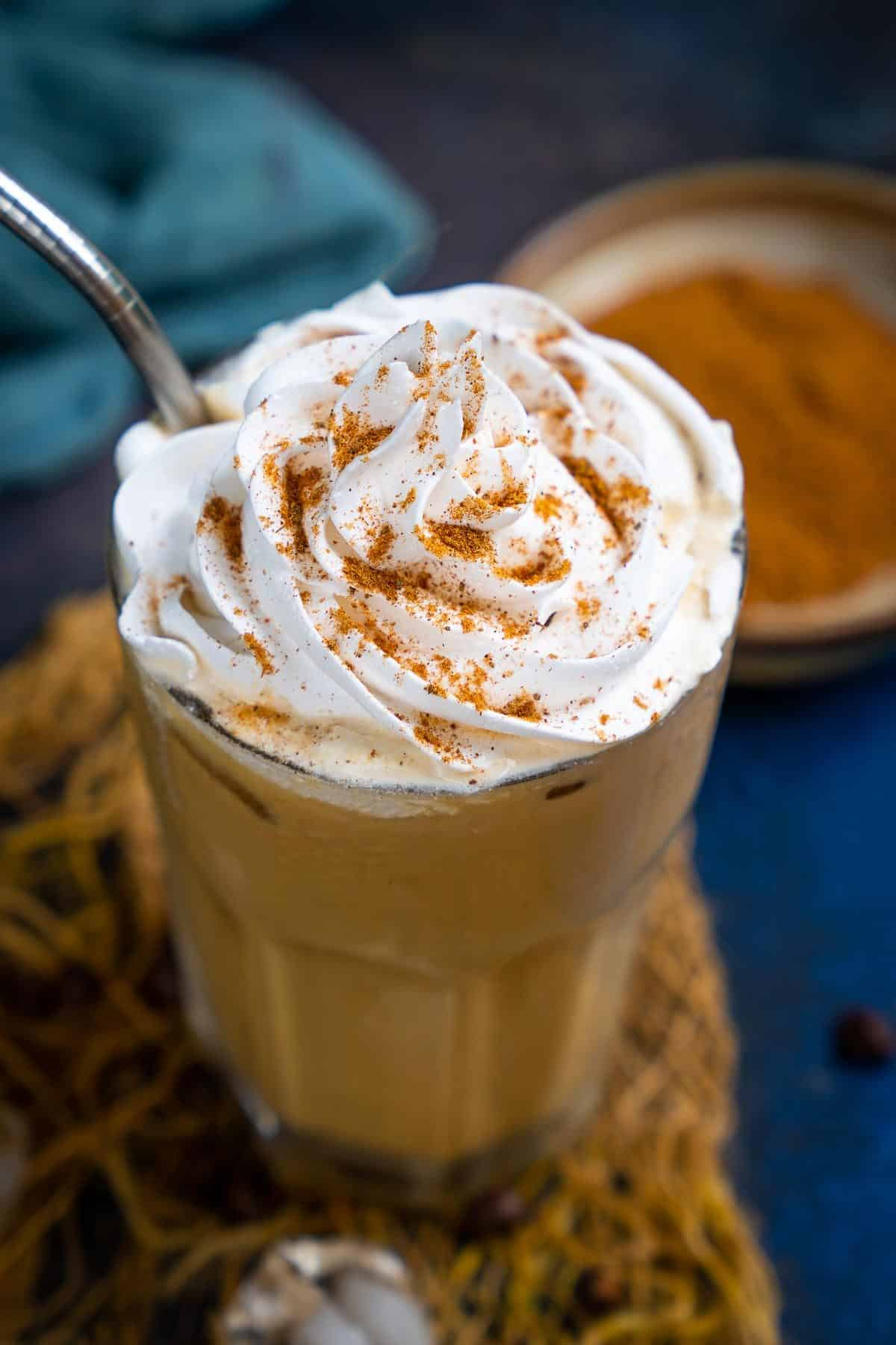 Ice Pumpkin Spice latte served in a glass.