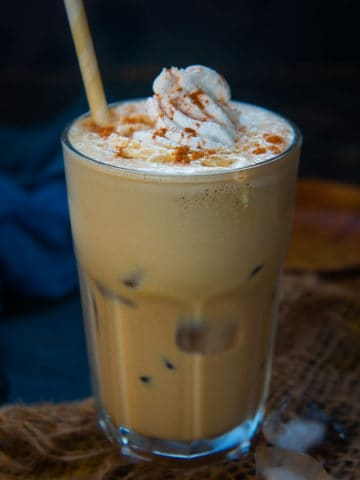 This Starbucks Copycat Iced Pumpkin Spice latte takes 5 minutes to come together in a fraction of the cost. It's made using real pumpkin and is perfect to sip on warmer fall and autumn days.