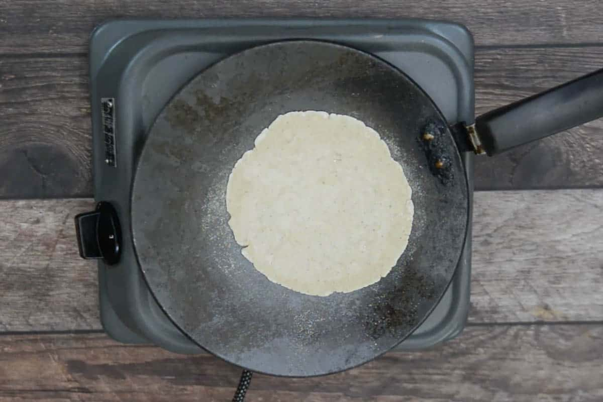 Bhakri transferred on a hot griddle.
