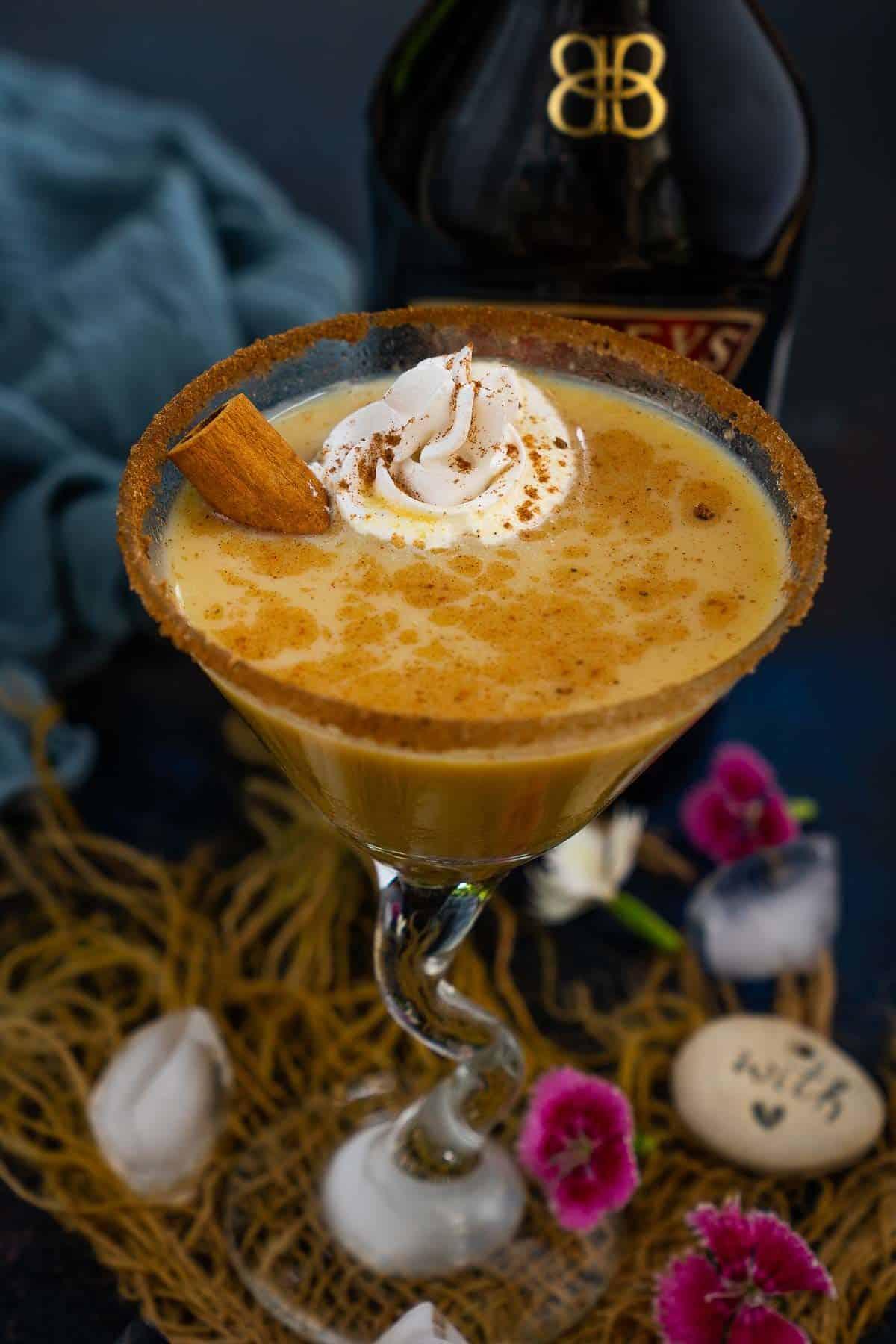 Pumpkin spice martini served in a martini glass.