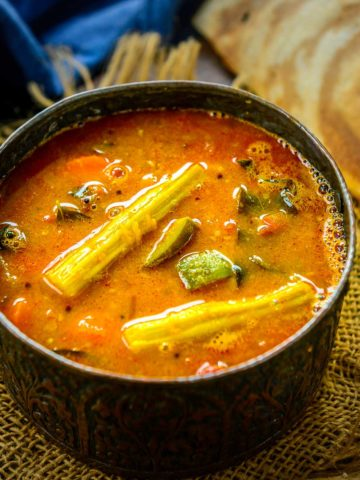 Sambar is a spicy and tangy lentil and vegetable stew that is a staple in South Indian homes. Sharing my most sought-after sambar recipe with you all in this post. Serve it with dosa, idli, uttapam, or pongal for a hearty meal (traditional pressure cooker & instant pot versions).