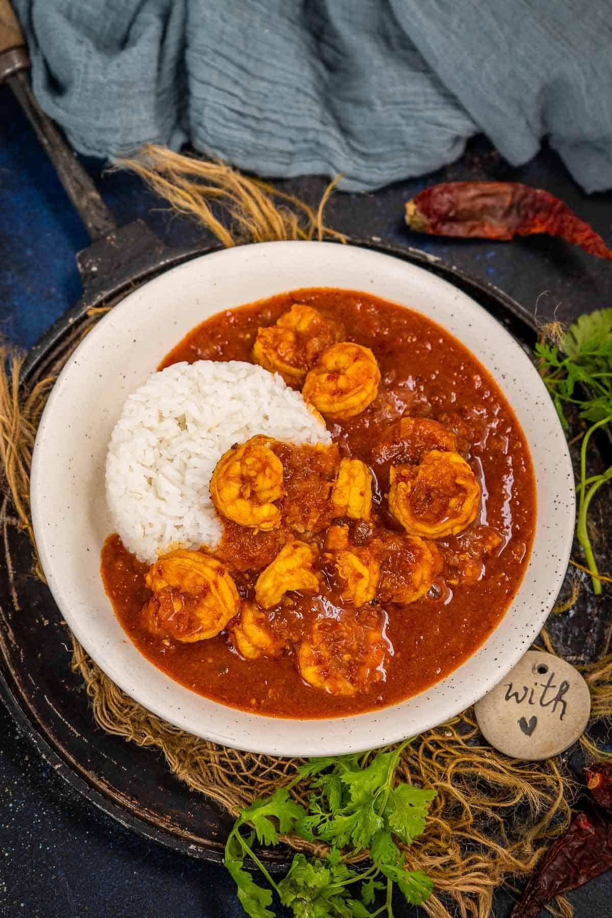 Shrimp vindaloo served in a bowl.