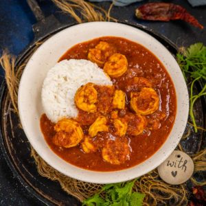 Shrimp Vindaloo (Prawn Vindaloo) is a Goan style curry made using fresh shrimp simmered in a sweet, spicy and tangy curry. Serve it with steamed rice or naan, this one won't disappoint you. Here is how to make it.