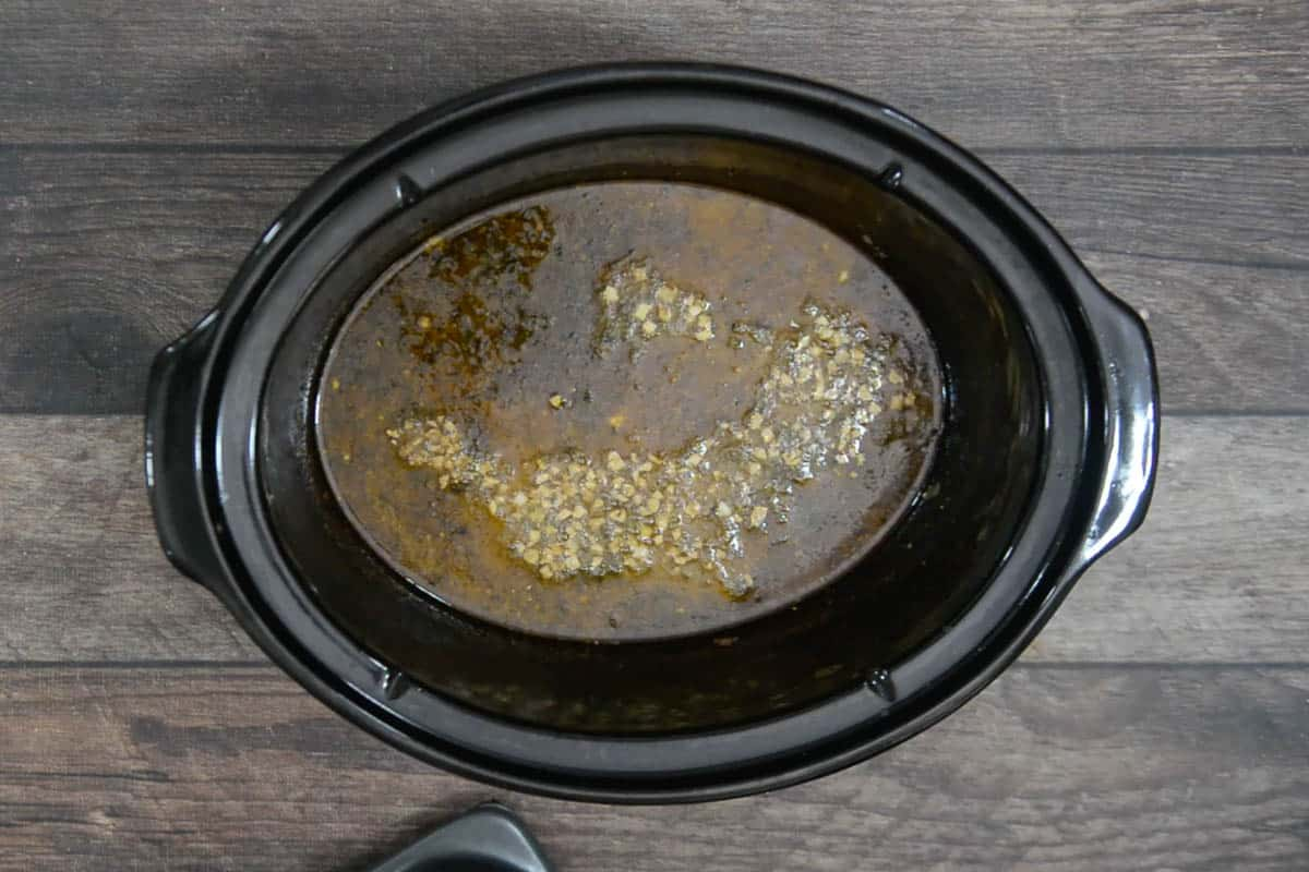 Tempering poured over ready slow cooker dal makhani.