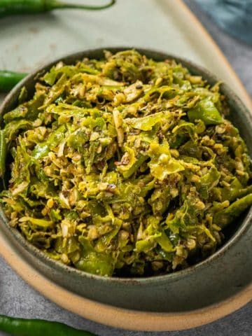 Made using fresh green chilies and garlic, Thecha is a Maharashtrian accompaniment that is served with Bhakri. It is like a spicy chutney which perks up any meal.