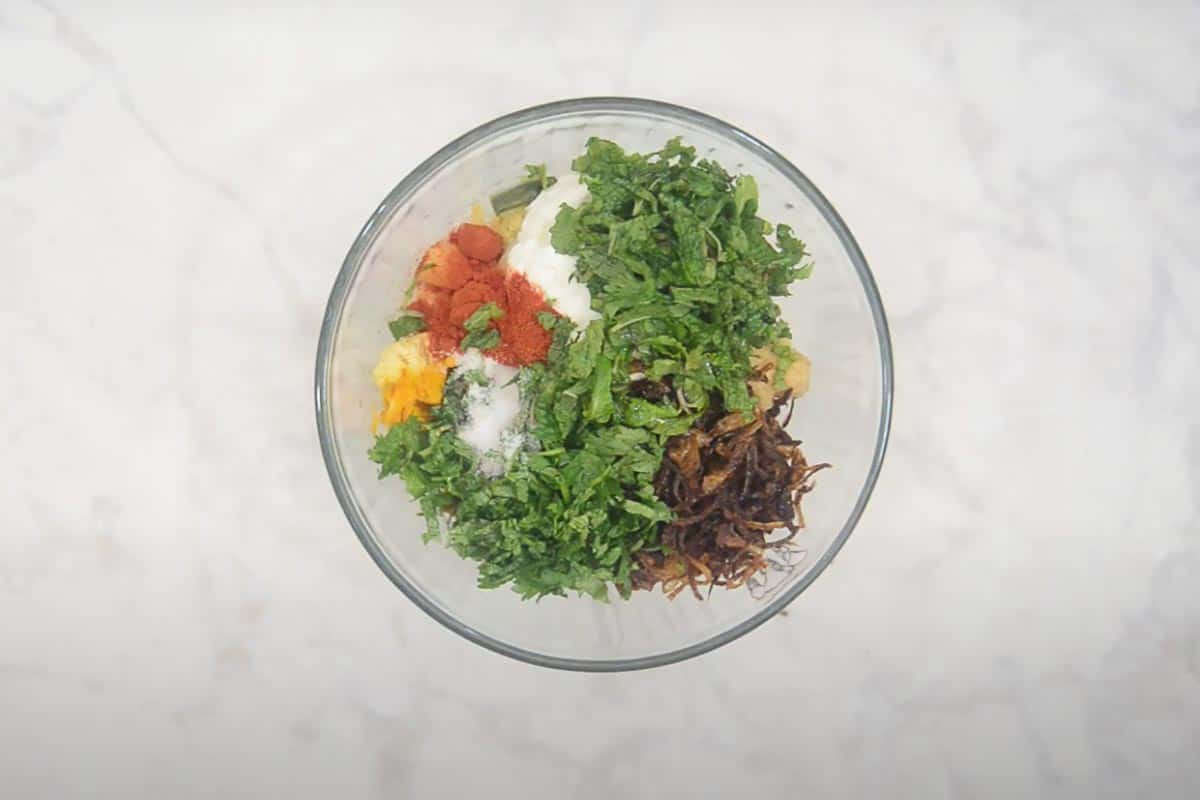 Vegetables mixed with marinating ingredients.