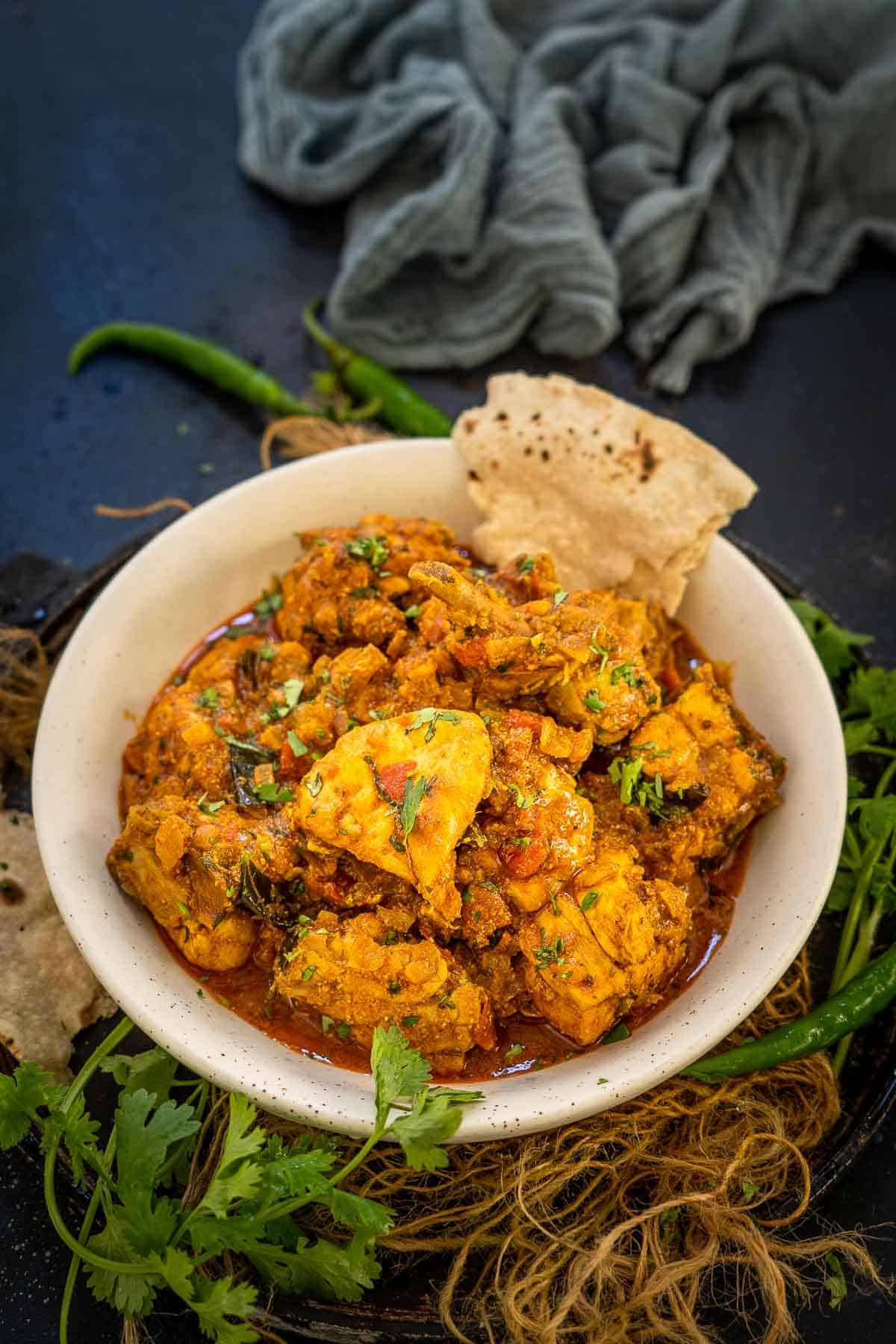 Andhra chicken curry served in a bowl.