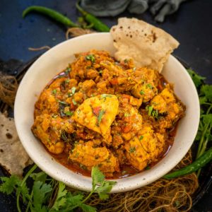 Andhra Chicken Curry is a spicy and flavorful chicken curry from the South Indian state Andra Pradesh in India. This curry gets its unique flavor from the freshly roasted spice mix. Here is how to make it.
